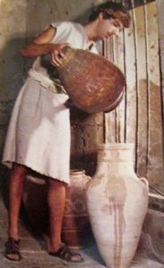 Servant Filling Large Jars